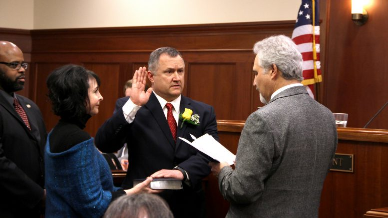 65a8573fc31 Sen. Mike Shower is sworn in by Senate President Pete Kelly with fellow  Mat-Su Valley Sens. Shelley Hughes and David Wilson by his side on Monday